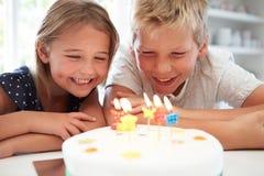 Children Celebrating Birthday With Cake Stock Images