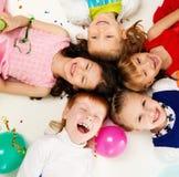 Children celebrating birthday Stock Photo