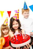 Children celebrating birthday Stock Photography