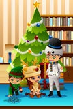 Children Celebrating Christmas in Front of Christmas Tree Stock Photo