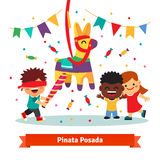 Children celebrating Posada by breaking Pinata Royalty Free Stock Images