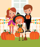 Children in celebration of Halloween on the doorstep Stock Photos