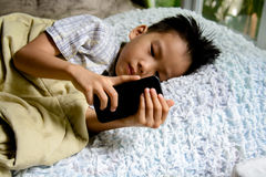 Children and cellphone Stock Photos