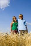 Children in cereal Stock Image