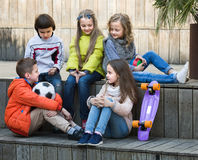 Children  chatting outdoors Stock Photography