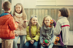 Children  chatting outdoors Royalty Free Stock Images