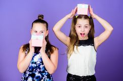 Children cheerful hold gift boxes. Kids girls delighted gift. Girls adorable celebrate birthday. Kids happy loves. Birthday gifts. Shopping and holidays royalty free stock image