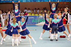Children cheerleaders team perform stunts. MOSCOW - MAR 24:  Girls and boys from children cheerleaders team perform stunts at Championship and Contests of Moscow Stock Photo