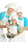 Children in chef uniforms Stock Photography