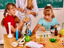 Children in chemistry class Royalty Free Stock Images