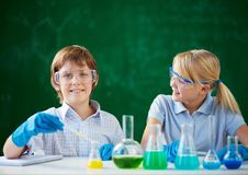 Children at chemistry lesson Royalty Free Stock Images