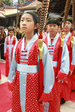 Children in Chinese Robes. Young children wear Chinese clothes in the ceremony at the Confucian temple in Taiwan. They are students in the elementary school near Royalty Free Stock Image