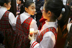 Children of choir holding candles ready admission Royalty Free Stock Images