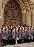 Children choir singing Christmas carols in front of the Bath Abbey. School children choir singing Christmas carols in front of the Bath Abbey in Bath, England royalty free stock photos