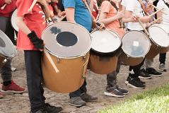 Group of young boys practice playing the drum in the street royalty free stock photos