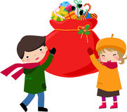 Children and Christmas bag Royalty Free Stock Image