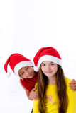 Children in christmas caps Stock Images
