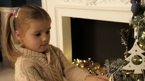 Children and Christmas. Child at Christmas. decorating a Christmas tree. stock photography