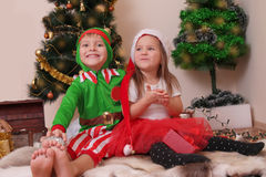 Children in Christmas costumes having fun Stock Image