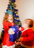 Children in Christmas costumes. Little helpers of Santa Claus stock photo