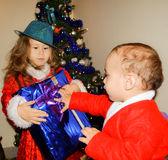Children in Christmas costumes. Little helpers of Santa Claus stock images