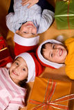 Children and Christmas gifts Stock Photos