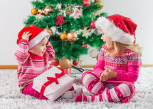 Children With Christmas present Royalty Free Stock Photos
