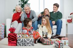 Children With Christmas Presents While Family Royalty Free Stock Photo
