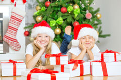 Children with Christmas tree Stock Images