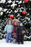 Children and Christmas tree Stock Images
