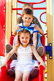 Children on the chute. Lovely school aged children on the chute Stock Photo