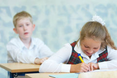 Children in a class. Children writing in a class royalty free stock photos