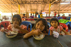 Children in the classroom at lunch time at school. KOH CHANG, THAILAND - FEB 8, 2016: Unidentified children in the classroom at lunch time at school by project Stock Photo
