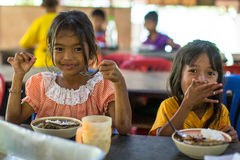 Children in the classroom at lunch time at school by project Cambodian Kids Care. KOH CHANG, THAILAND - FEB 8, 2016: Unidentified children in the classroom at Royalty Free Stock Photo