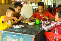 Children in the classroom at lunch time at school by project Cambodian Kids Care. KOH CHANG, THAILAND - FEB 8, 2016: Unidentified children in the classroom at Royalty Free Stock Images