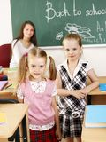 Children in classroom with teacher. Royalty Free Stock Photo