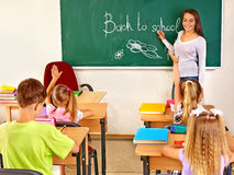 Children in classroom with teacher. Stock Images