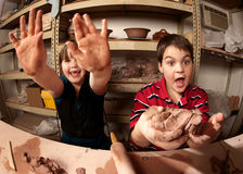 Children in a clay studio Stock Photography