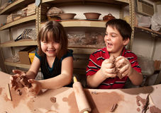 Children in a clay studio Royalty Free Stock Photo
