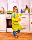 Children cleaning  kitchen Royalty Free Stock Images