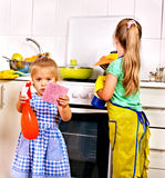 Children cleaning  kitchen. Stock Image