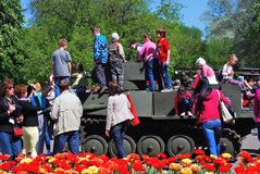 Children climb on military machine in Gorki park in Moscow. Stock Photos