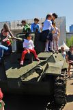 Children climb on military machine in Gorki park in Moscow. Stock Image