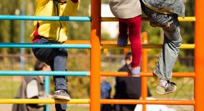 Children climb on the stairs in the park Royalty Free Stock Image