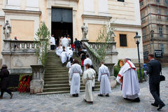 Children climb the stairs to the service in the Catholic Church Stock Images