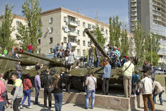 Children climb tanks removed from service in the Soviet army Stock Images