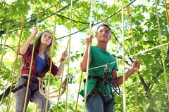 Children climbing in adventure park. Summer camp. Children climbing in adventure park outdoors. Summer camp stock photo
