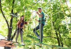 Children climbing in adventure park. Summer camp royalty free stock photos