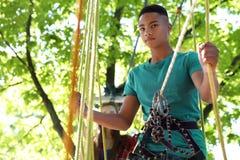 Children climbing in adventure park. Summer camp stock images