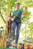 Children climbing in adventure park. Summer camp stock photo